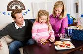 Hanukkah: Little Girl Wins Dreidel Game — Stock Photo