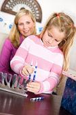 Hanukkah: Girl Preparing Menorah for Hanukkah — Stock Photo