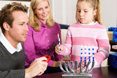 Hanukkah: Lighting Hanukkah Candles — Stock Photo