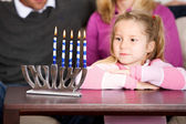 Hanukkah: Little Girl Looks at Candles — Stock Photo