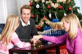 Holidays: Family Playing Dreidel Game — Stock Photo