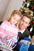 Holidays: Dad Watches Girl Light Candles — Stock Photo