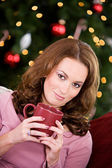 Christmas: Woman Relaxing With Hot Drink — Stock Photo