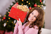 Christmas: Woman Trying To Guess Christmas Gift — Stockfoto