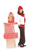 Christmas: Winter Woman Standying By Stack of Gifts — Stock Photo