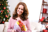 Christmas: Woman Received Flowers For Holiday Gift — Stock Photo
