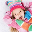 Winter: Laughing Little Girl Lying In Snow — Stok fotoğraf