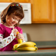 Kitchen Girl: Ready to Eat a Banana — Foto Stock