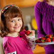 Kitchen Girl: Taking a Berry from a Plate — Foto Stock