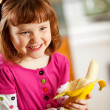 Kitchen Girl: Eating a Banana — Foto Stock