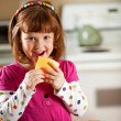 Kitchen Girl: Eating a Slice of Cheese — Foto Stock