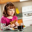 Kitchen Girl: Eating a Grilled Cheese — Stockfoto