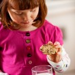 Kitchen Girl: Dunking Cookie in Milk — Stockfoto