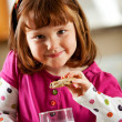 Kitchen Girl: Eating a Dunked Cookie — Stock Photo