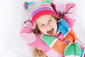 Winter: Laughing Little Girl Lying In Snow — Stock Photo