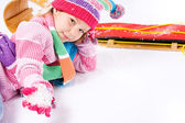 Winter: Little Sled Girl With Handful of Snow — Stock Photo