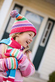 Winter: Little Girl With Snowflakes On Clothing — Stock Photo