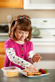 Kitchen Girl: Making a Grilled Cheese Sandwich — Stock Photo