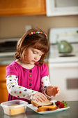 Kitchen Girl: Young Girl Making Own Lunch — Stock Photo