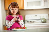 Kitchen Girl: Having Juice with Lunch — Stock Photo