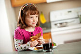 Kitchen Girl: Eating a Grilled Cheese — Stock Photo
