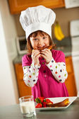 Kitchen Girl: Kid Chef Eating Lunch — Stock Photo