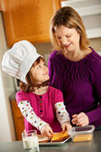Kitchen Girl: Cooking with Mom — Stock Photo