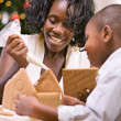 Christmas: Mother And Son Build Holiday Gingerbread House — Stockfoto