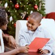 Christmas: Sharing A Christmas Story Book — Stock Photo