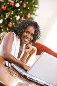 Christmas: Woman Using Laptop During Holiday — Stock Photo