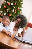 Christmas: Boy Using Computer Mouse — Stock Photo