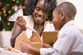 Christmas: Mother And Son Build Holiday Gingerbread House — Stock Photo