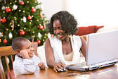 Christmas: Mother And Son Using Laptop — Stock Photo