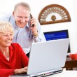 Stock Photo: Seniors: Senior Couple Gets Telephone Support For Computer