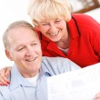 Seniors: Happy To Pay Off Bills — Stock Photo