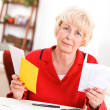 Seniors: Upset Senior Holding Bill Payment Letters — Stock Photo