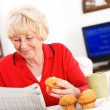 Seniors: Woman Reading Paper At Breakfast — Stock Photo