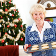 Christmas: Senior Woman Holding Tray Of Holiday Cookies — Stock Photo