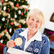 Christmas: Having a Christmas Cookie — Stock Photo