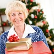 Christmas: Senior Woman Holding Christmas Gifts — Stockfoto