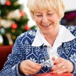 Christmas: Pulling Off Tape To Seal Gift — ストック写真
