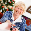 Christmas: Senior Woman Wrapping Gifts — Stockfoto