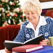 Stock Photo: Christmas: Senior WomLooks At Photo Albums