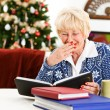 Christmas: Senior Woman Looks At Photo Albums — Stockfoto