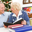 Christmas: Couple Looking at Scrapbooks — Stockfoto