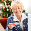 Christmas: Woman Using Credit Card — Stock Photo