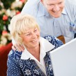 Christmas: Couple Laughing At Funny Email — Stockfoto