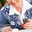 Christmas: Woman Looking For Telephone Number — Stock Photo