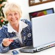 Stock Photo: Christmas: WomUsing Credit Card Online