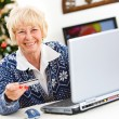 Christmas: Woman Using Credit Card Online — Stock Photo